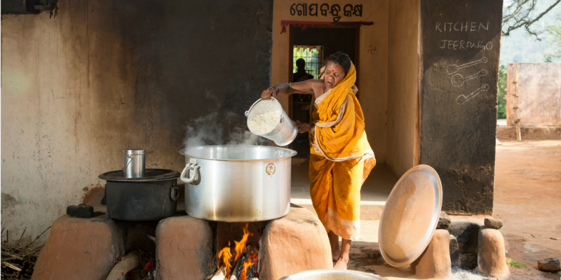 Woman cooking school meals
